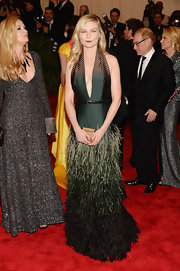 Kirsten Dunst showed off her sexy side with this hunter green gown that featured a plunging V-neck and an ombre feathered skirt.