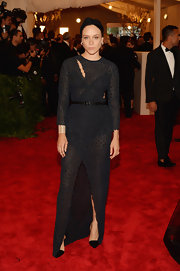 Chloe Sevigny rocked an all-black look when she wore this long-sleeve sheer gown that featured a high front slit.