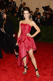 Kate Beckinsale chose this strapless asymmetrical hem dress for her slightly punk look at the 2013 Met Gala.