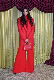 Sonam Kapoor matched her suit with an elegant red leather purse by Thale Blanc.