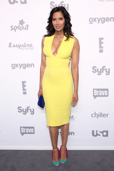 Padma Lakshmi Leather Clutch [nbcuniversal cable entertainment upfront,dress,clothing,cocktail dress,fashion model,yellow,shoulder,fashion,hairstyle,neck,sheath dress,new york city,the jacob k. javits convention center,padma lakshmi]