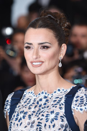 Penelope Cruz styled her hair into a braided bun for the 2019 Cannes Film Festival screening of 'Pain and Glory.'
