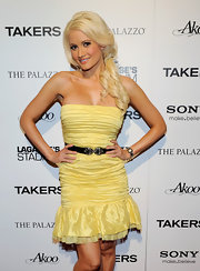 Holly Madison paired her strapless yellow dress with a black elastic belt embellished with gemstones.