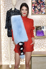 Kendall Jenner spruced up her romper with a luxurious Fendi fur stole for the Palazzo Fendi and Zuma inauguration.