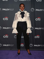 Tika Sumpter paired her top with high-waisted black trousers.