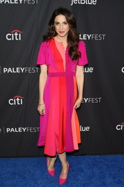 Marin Hinkle coordinated her dress with a pair of hot-pink pumps.