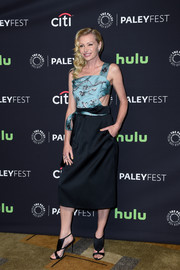 Ultra-modern strappy heels finished off Portia de Rossi's ensemble.