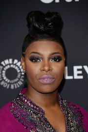 Ta'Rhonda Jones grabbed attention with her towering half-up pompadour during PaleyFest Los Angeles.
