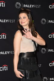 Katie Lowes accessorized with an elegant satin envelope clutch when she attended PaleyFest Los Angeles.