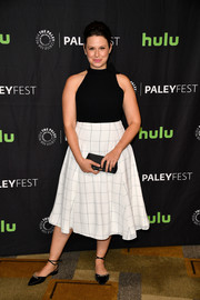 Katie Lowes styled her outfit with embellished black flats by Sarah Flint.
