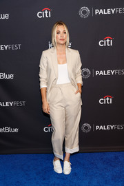Kaley Cuoco styled her suit with a pair of white monk-strap shoes.