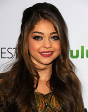 Sarah Hyland attended PaleyFest 2012 wearing her hair half-up with long loose waves.
