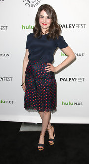 Alison Brie chose cute separates for her PaleyFest look, consisting of a simple blue blouse and a dotted skirt.