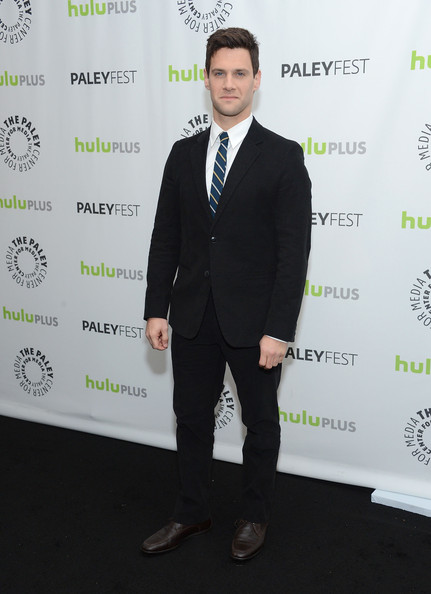 Justin Bartha added a bit of color to his classic black suit by pairing it with this blue striped tie.