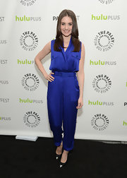 Alison Brie rocked a purple satin jumpsuit with pleated pants while attending PaleyFest.