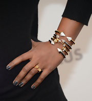 Mindy Kaling piled on the gold bracelets for a cool and edgy look at PaleyFest 2013.