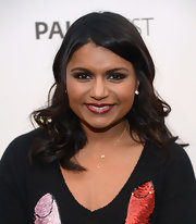 Mindy Kaling opted for a dark red lip to add some drama to her beauty look.