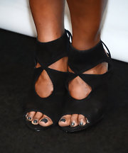 Mindy Kaling opted for funky cutout booties with a classic peep toe for her look at PaleyFest.