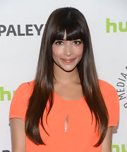 Hannah Simone stuck to her signature 'do with this long cut with straight-across bangs.