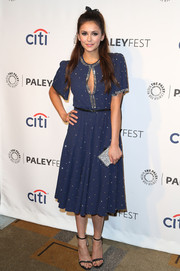 Nina Dobrev complemented her dress with an elegant pair of embellished black evening sandals by Aperlai.