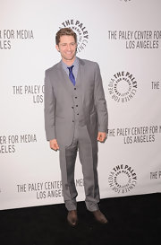 Matthew looked snazzy in a light gray suit at the Paleyfest 2011 event honoring 'Glee'. A royal blue tie and brown oxfords completed his look.