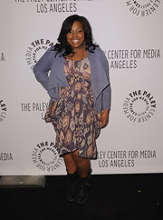 Amber Riley toughened her Ikat print dress with a pair of black leather combat boots.