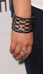 Jenna wore an ornate bangle bracelet complete with sparkling gemstones.