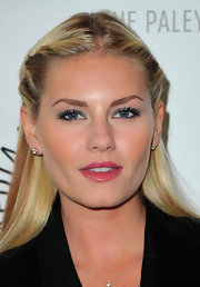 Shiny, hot pink lips provided a pop of color to Elisha Cuthbert's subtle hair and makeup look at An Evening With 'Happy Endings' presented by The Paley Center for Media. To get the look, try Yves Saint Laurent Volupte Sheer Candy Glossy Balm Crystal Color in Succulent Pomegranate.