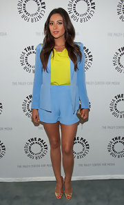 Shay Mitchell's periwinkle blue short suit looked summer light and breezy when paired with a bright neon top.