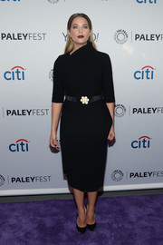 Ashley Benson looked very classy during PaleyFest New York 2015 in a little black dress with an asymmetrical neckline and a flower-embellished belt.