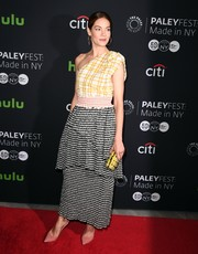 Michelle Monaghan teamed her frock with a beaded yellow clutch by Brian Atwood.
