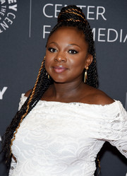Naturi Naughton wore a head full of braids with a top bun while attending PaleyLive NY.