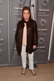 Kate Mulgrew arrived for the PaleyLive LA 'Orange is the New Black' event wearing a brown leather coat over a nude blouse and white pants.