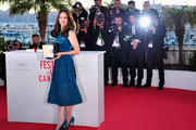 Actress Berenice Bejo poses with the 'Prix d'Interpretation Feminine' (Best Actress) award at the Palme D'Or Winners Photocall during the 66th Annual Cannes Film Festival at the Palais des Festivals on May 26, 2013 in Cannes, France.
