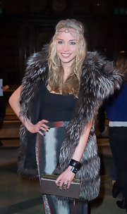 Noelle Reno showed her hippie-inspired style with a long skirt, headband and over-sized fur vest.