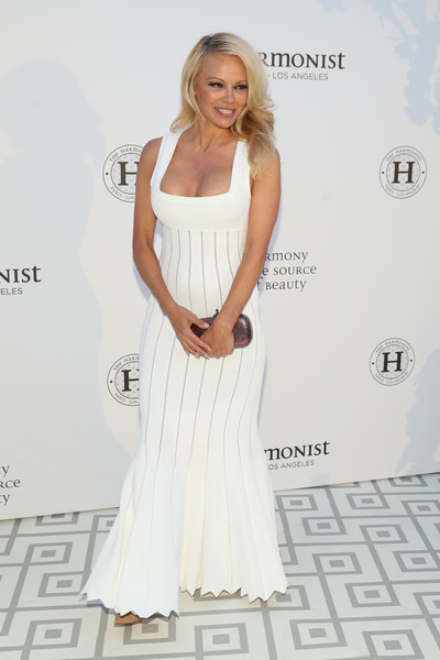 Pamela Anderson Metallic Clutch [white,clothing,dress,shoulder,gown,fashion model,red carpet,fashion,hairstyle,lady,cannes,france,club albane,harmonist gala event,cannes film festival,the harmonist gala event,pamela anderson]