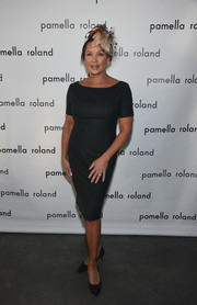 Vanessa Williams opted for a simple green sheath dress when she attended the Pamella Roland fashion show.