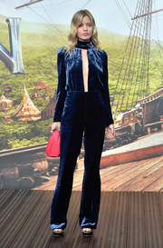 Georgia May Jagger rocked a blue Sonia Rykiel velvet jumpsuit with a neck-to-navel cutout during the world premiere of 'Pan.'