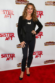 Melora Hardin topped off her monochromatic red carpet look with this asymmetrical black blazer.