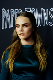 Cara Delevingne opted for a simple center-parted half-up hairstyle when she attended the 'Paper Towns' Australian premiere.