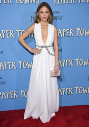 Halston Sage worked a sultry-goddess vibe at the 'Paper Towns' New York premiere in a white Miu Miu gown with a down-to-the-navel neckline and a bejeweled waist.