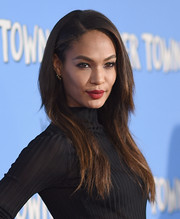 Joan Smalls swiped on some red lipstick for a pop of color to her dark outfit.