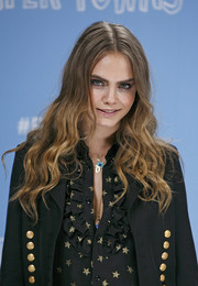 Cara Delevingne attended the 'Paper Towns' photocall sporting long center-parted waves.