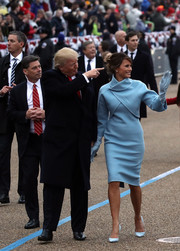 Melania Trump looked very refined in a '60s-inspired pastel-blue cropped jacket and dress combo by Ralph Lauren while walking the parade during the Presidential Inauguration.