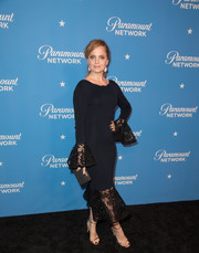 Mena Suvari got dolled up in a black mermaid gown with a lace hem and cuffs for the Paramount Network launch party.
