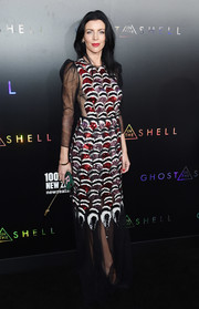 Liberty Ross flashed some side cleavage in a partially sheer, scallop-sequined gown by Gucci at the premiere of 'Ghost in the Shell.'