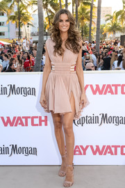 Izabel Goulart complemented her dress with a pair of nude satin sandals.