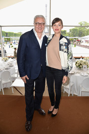 Marion Cotillard teamed a printed bomber jacket with a beige sweater and black jeans for the Paris Eiffel Jumping event.