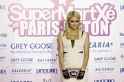 Paris is a glam queen at the Supermartxe VIP Party in black Chanel fingerless leather gloves.