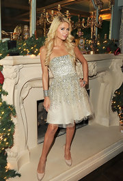 Paris Hilton wore a beaded strapless ivory dress for her Christmas party in LA.